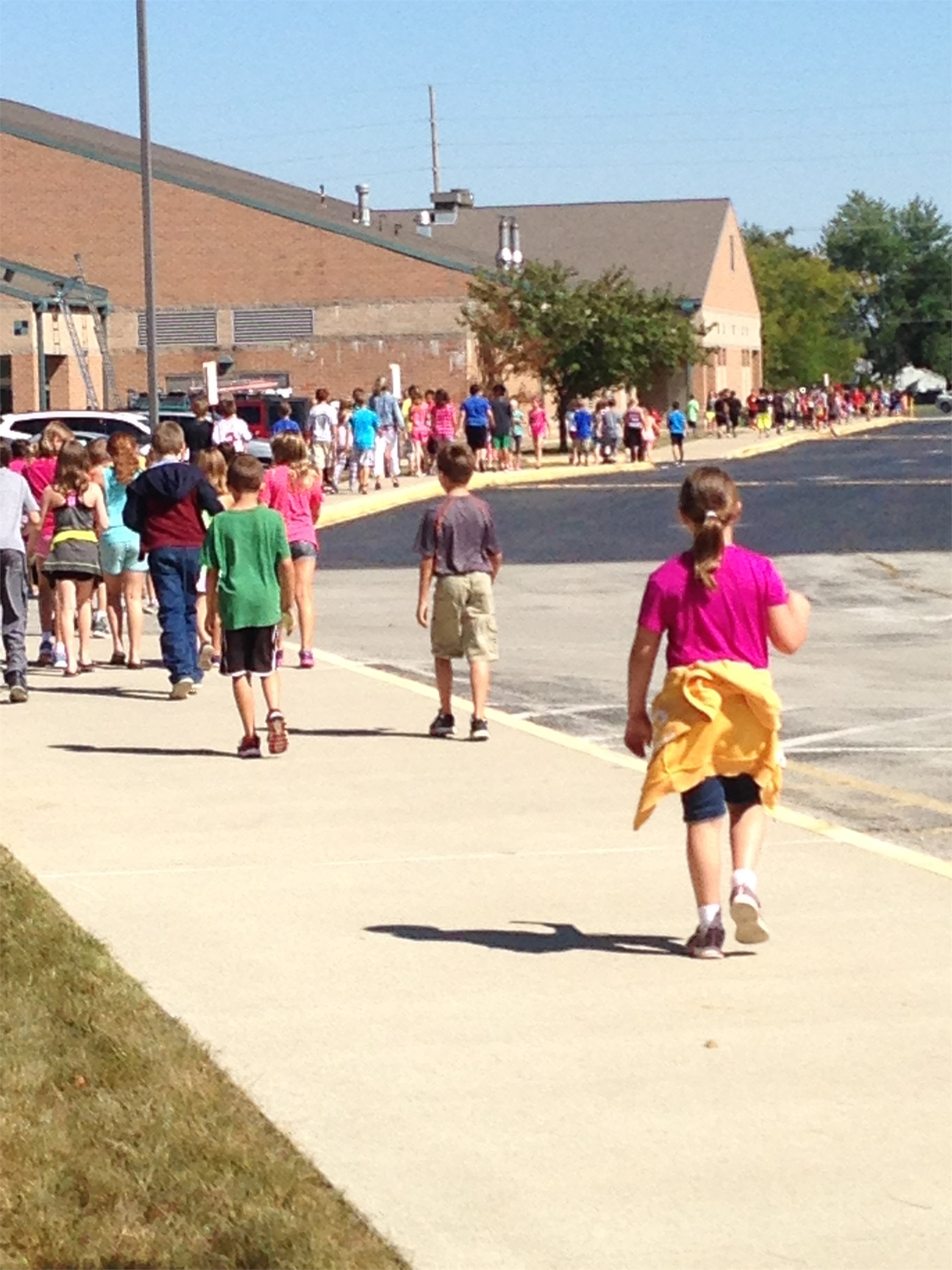 Students running/walking during Mileage Club, which is held every Thursday afternoon during recess.
