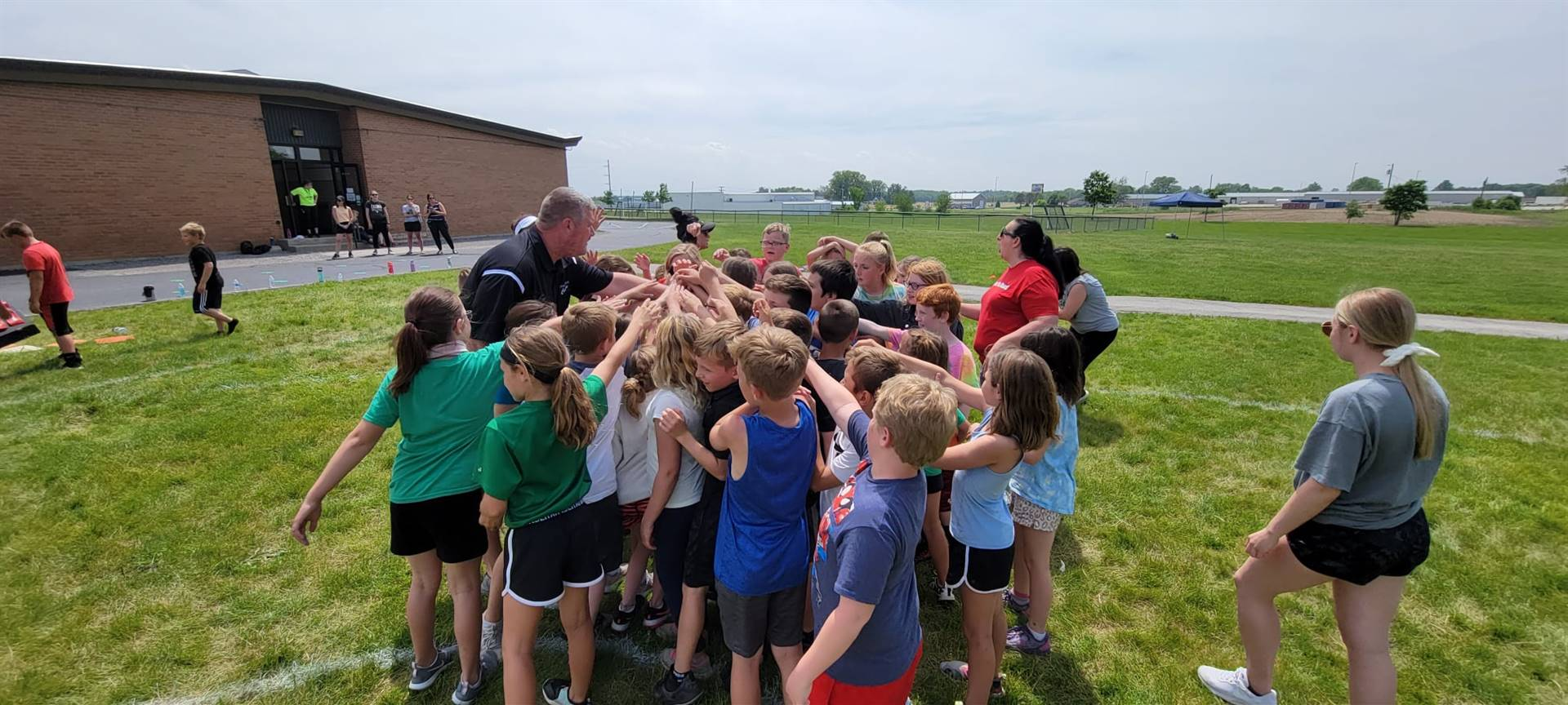 Mr. Ahrens teaching about teamwork and respect during the kickball tournament.