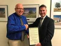 Dr. Ken Schmiesing (left) accepts Sealed Mayoral Proclamation from Mayor Jeff Hazel.