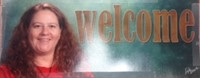 Picture of Wendy Mitchell-Payne and the word WELCOME