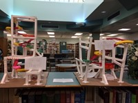 Students create roller coasters with paper and tape.